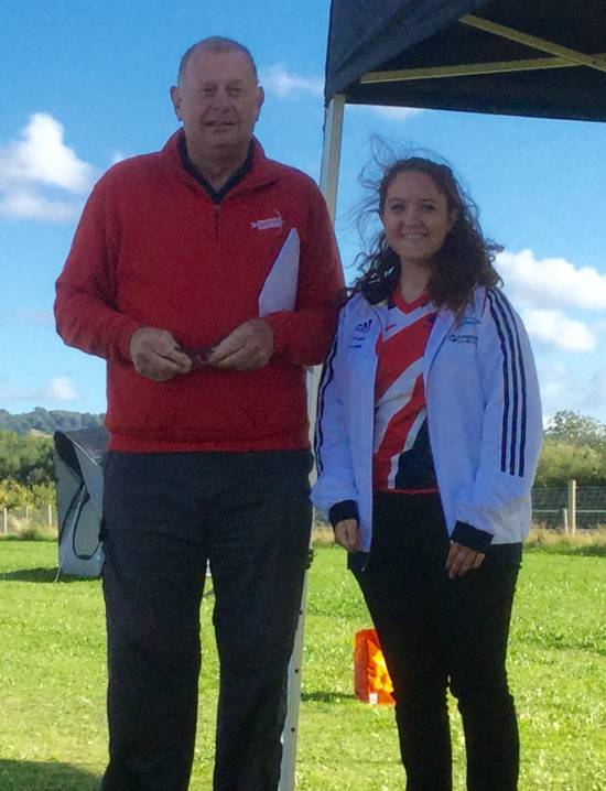 Lucy Mason who was Lady Paramount receiving her award from Roger Crang for winning the County Title and breaking anothertBritish Record.